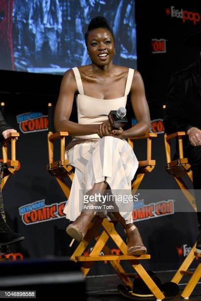 Danai Gurira speaks onstage during The Walking Dead panel during New York Comic Con at The Hulu Theater at Madison Square Garden on October 6 2018 in...