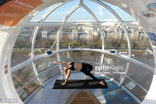 Danai of Bodyism doing yoga aboard a London Eye capsule as part of a uplifting masterclass offered by the London Eye