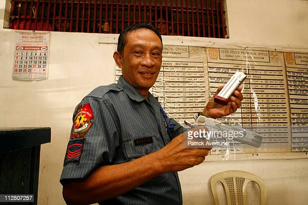 Danao policemen equipped with guns made at the WORLD gun manufacturing cooperative specifically 45mm handguns similar to Berettas The local...