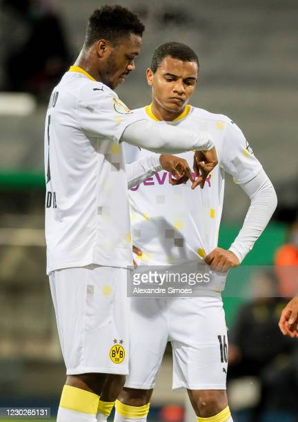 Dan-Axel Zagadou and Manuel Akanji of Borussia Dortmund in action during the DFB Cup second round match between Eintracht Braunschweig and Borussia...
