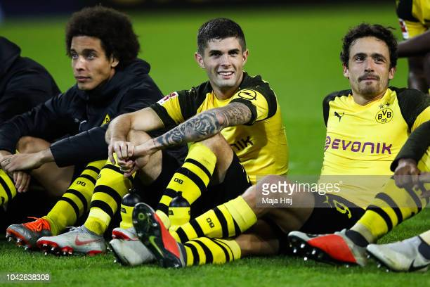 DanAxel Zagadou Christian Pulisic and Thomas Delaney of Borussia Dortmund celebrate with fans after the Bundesliga match between Borussia Dortmund...
