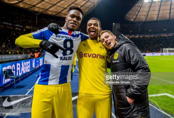 DanAxel Zagadou Manuel Akanji and Thorgan Hazard of Borussia Dortmund celebrates after winning the Bundesliga match between Hertha BSC and Borussia...