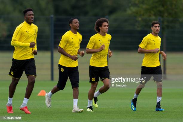 DanAxel Zagadou of Borussia Dortmund Abdou Diallo of Borussia Dortmund Axel Witsel of Borussia Dortmund and Achraf Hakimi of Borussia Dortmund run...