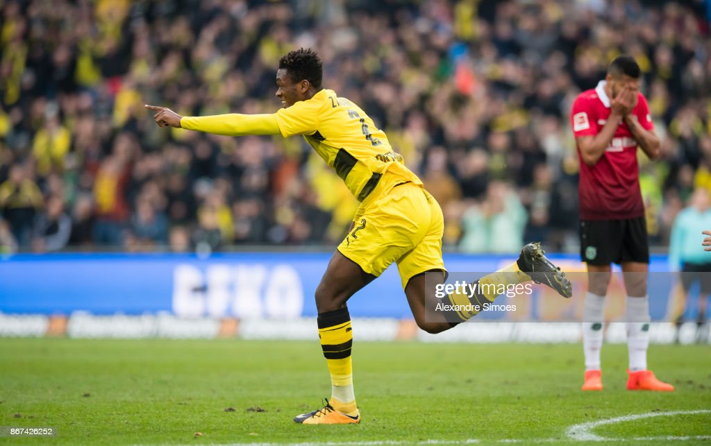 Dan-Axel Zagadou of Borussia Dortmund celebrates scoring the goal to the 1:1 during the Bundesliga match between Hannover 96 and Borussia Dortmund at HDI-Arena on October 28, 2017 in Hanover, Germany.