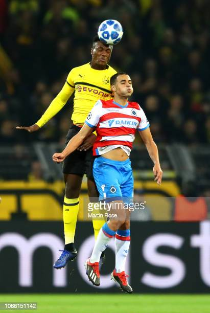 DanAxel Zagadou of Borussia Dortmund headers the ball over Sofyan Amrabat of Club Brugge during the UEFA Champions League Group A match between...