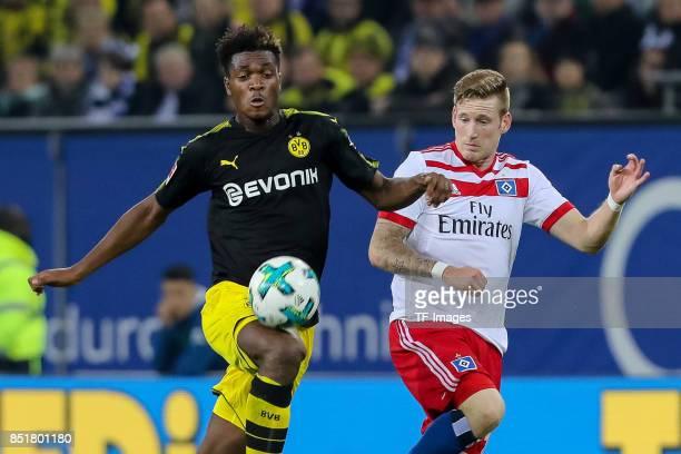 DanAxel Zagadou of Dortmund and Andre Hahn of Hamburg battle for the ball during the Bundesliga match between Hamburger SV and Borussia Dortmund at...