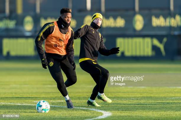 DanAxel Zagadou of Dortmund and Marco Reus of Dortmund battle for the ball during a training session at BVB trainings center on February 05 2018 in...
