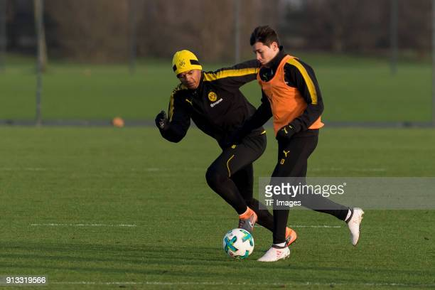 DanAxel Zagadou of Dortmund and Raphael Guerreiro of Dortmund battle for the ball during a training session at BVB trainings center on January 30...