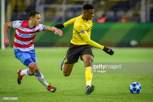 DanAxel Zagadou of Dortmund and Sofyan Amrabat of Bruegge battle for the ball during the Group A match of the UEFA Champions League between Borussia...