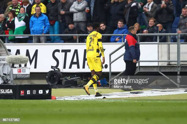 DanAxel Zagadou of Dortmund leaves the pitch after referee Patrick Ittrich gave him a red card during the Bundesliga match between Hannover 96 and...