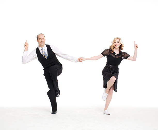 dance couple doing a lindyhop dance move