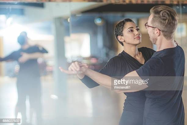 dance couple in studio - dance studio stock pictures, royalty-free photos & images
