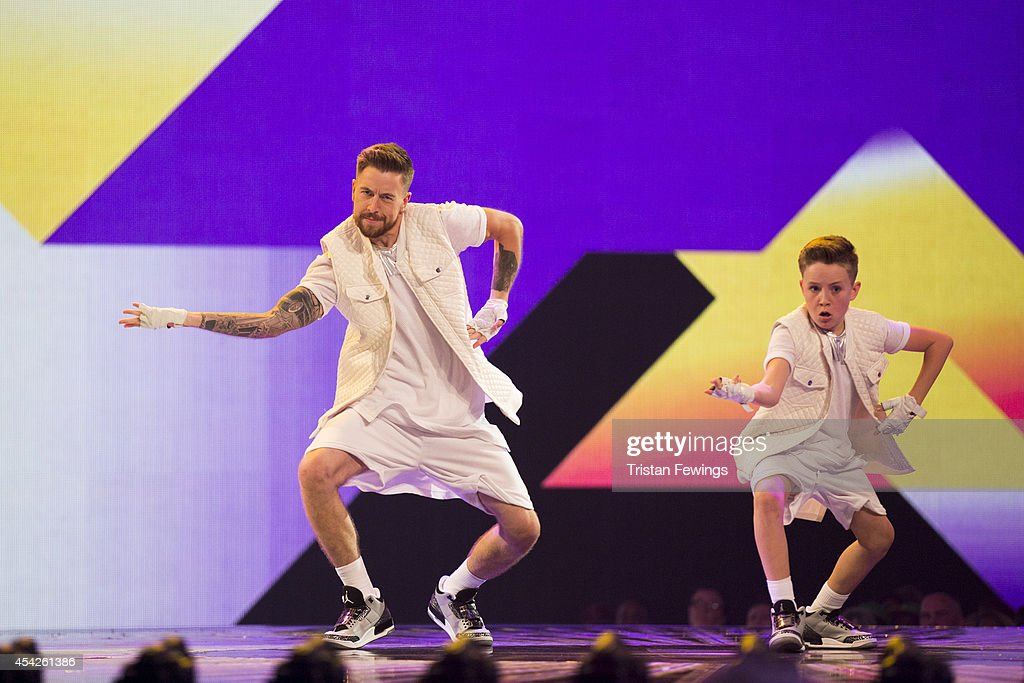 Dance duo Duplic8 perform on stage during the third live show of 2014's 'Got To Dance' at Earls Court on August 27, 2014 in London, England.