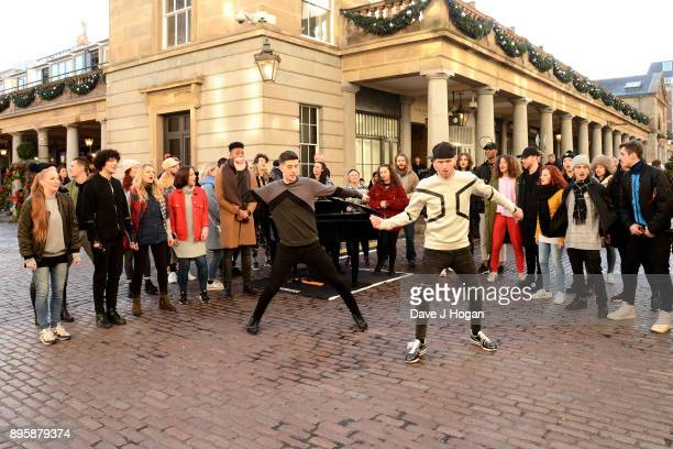 Dance duo Twist and Pulse perform at 'The Greatest Showman' flashmob at Covent Garden on December 18, 2017 in London, England.