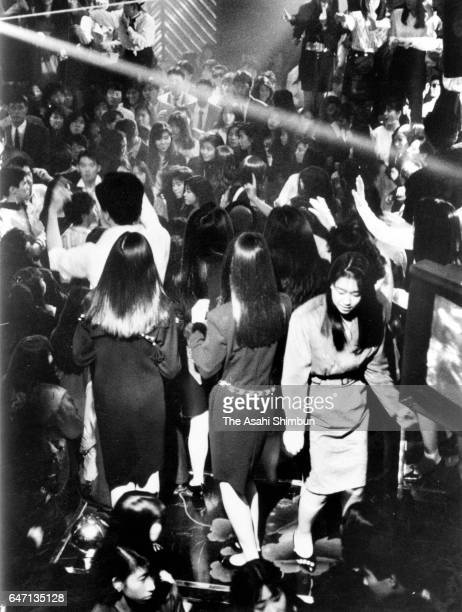 Dance floor is packed at a discotheque circa 1988 in Tokyo Japan