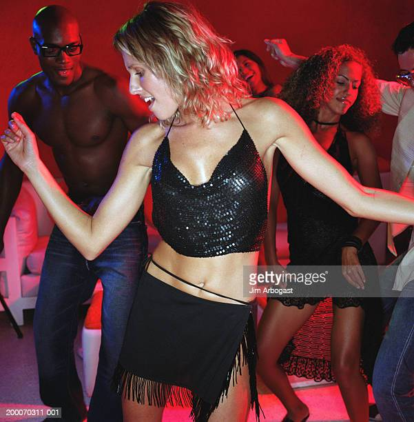 dance floor of nightclub (focus on woman) - halter neck stock pictures, royalty-free photos & images