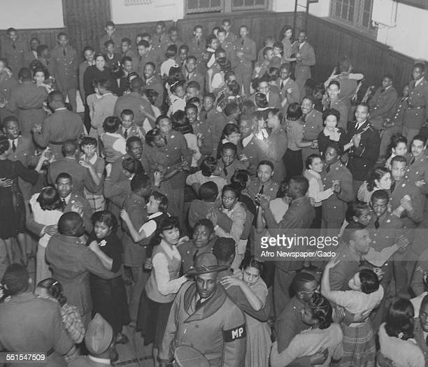 A dance for AfricanAmerican soldiers and their wives and girlfriends in World War Two the United Services Organization in action February 2 1943
