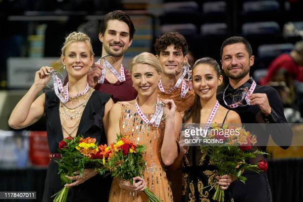 Dance gold medalists Piper Gilles and Paul Poirier of Canada pose for photographers with silver medalists Madison Hubbell and Zachary Donohue of the...