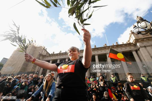 A dance group performs on the steps of Parliament house on July 6 2018 in Melbourne Australia The march marks the start of NAIDOC Week which runs...