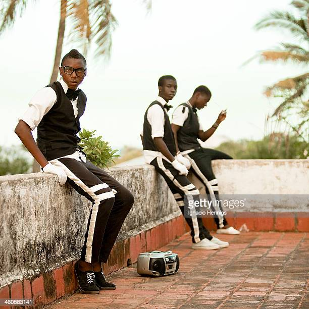 CONTENT] A dance group resting during a shooting of a music video for a local coastal artist in Likoni Mombasa Kenya