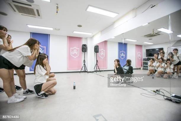 A dance instructor center watches as contestants practice dance moves during the production of the 'Idol School' reality television show by CJ EM...