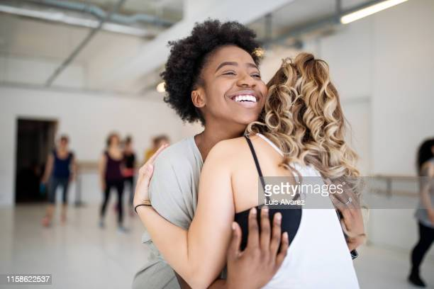 dance instructor greeting students at fitness studio - black and white photos et images de collection