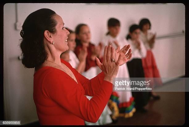 A dance instructor leads a group of young girls at a flamenco dancing class at Angelita Gomez's Escuelas De Baile Flamengo Spain | Location Escuelas...
