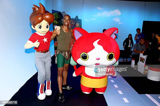 'Dance It Out' founder Billy Blanks Jr interacts with costume character Jibanyan at the YOKAI WATCH 2 preview event at Siren Studios on September 8...