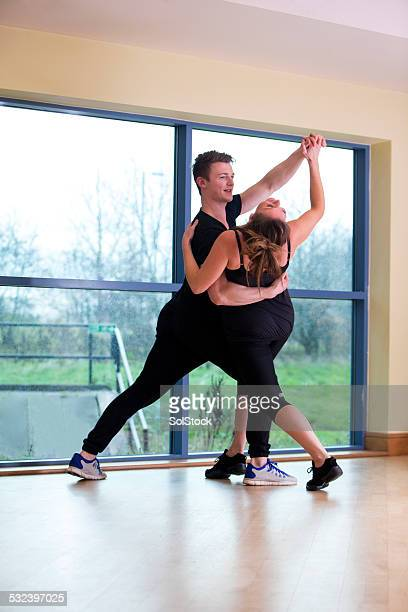 dance lesson - salsa dancing stock photos and pictures