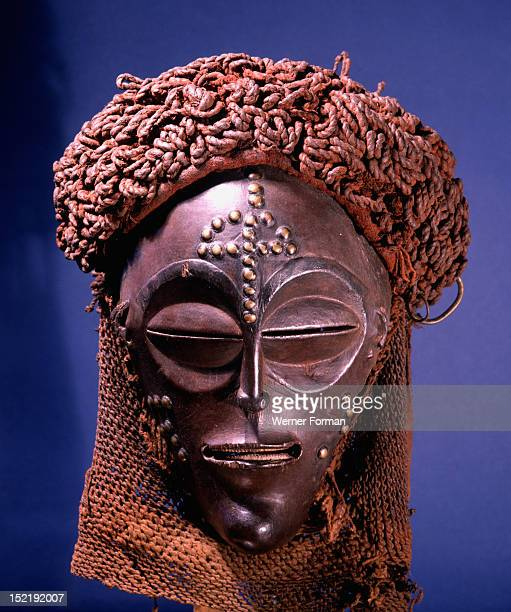 Dance mask of a type known as Mwana Pwo regarded as an idealised depiction of a beautiful young girl Angola / Democratic Republic of Congo Equatorial...