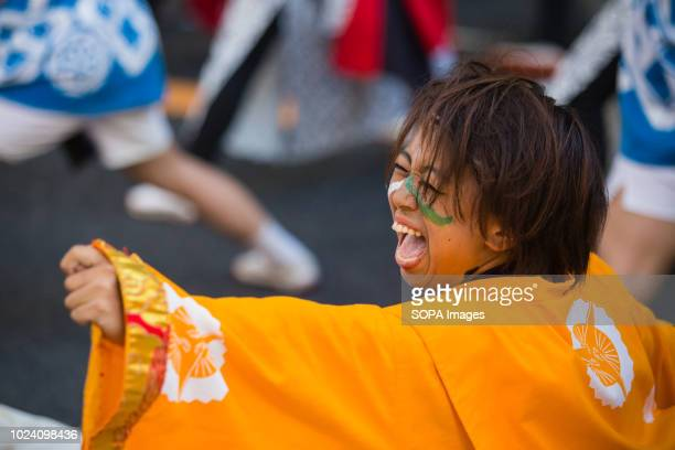A dance participant seen with a painted face during the performance Nippon Domannaka Festival in Nagoya Aichi One of the largest dance festival in...