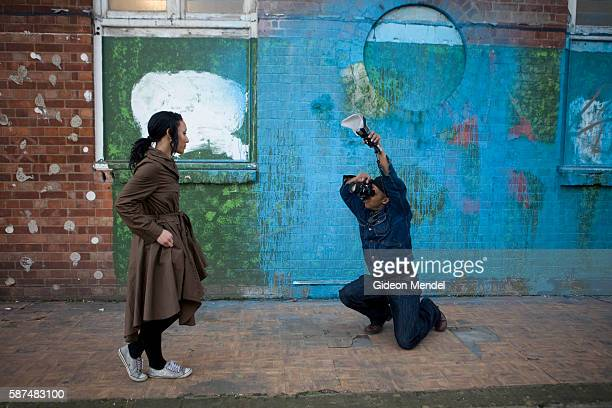 A dance students poses for an informal fashion photo shoot using an urban graffiti covered background close to London Fields in Hackney Hackney is...