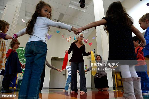 Dance teacher Toby Hankin middle leads preschoolers in dance during the Creative Movement Class at the Mapleton Early Childhood Center on March 30...