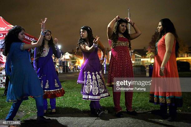 A dance troop rehearse their moves as they celebrate the Hindu festival of Diwali on October 23 2014 in Leicester England Up to 35000 people attended...