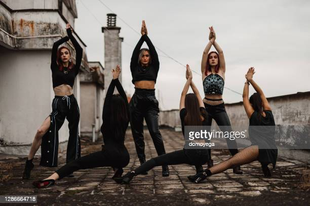 dance troupe on top of the building in the city - competition group stock pictures, royalty-free photos & images