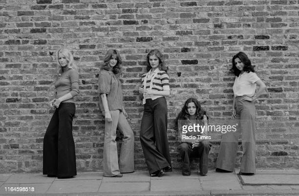 Dance troupe Pan's People Babs Lord Deedee Wilde Sue Menhenick Cherry Gillespie and Ruth Pearson posing in front of a wall during a break in...