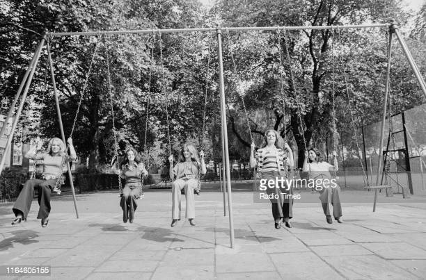 Dance troupe Pan's People Ruth Pearson Sue Menhenick Cherry Gillespie Babs Lord and Deedee Wilde posing on swings in the park during rehearsals for...