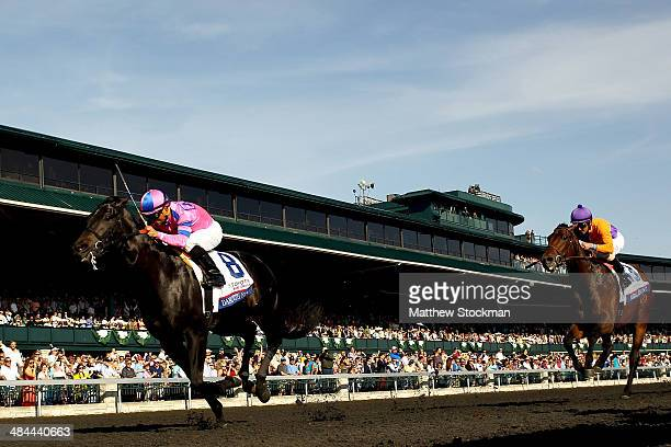 Dance With Fate ridden by Corey Nakatani crosses the finish line ahead of Medal Count ridden by Robby Albarado to win the Toyota Blue Grass Stakes at...