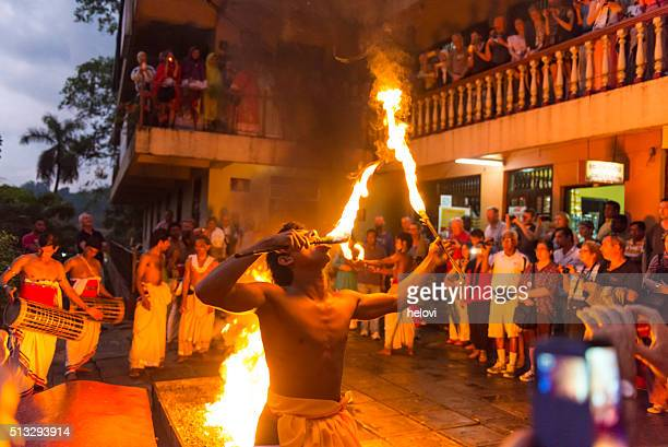 dance with fire in front of sacred tooth relic temple - dalada maligawa stock photos and pictures