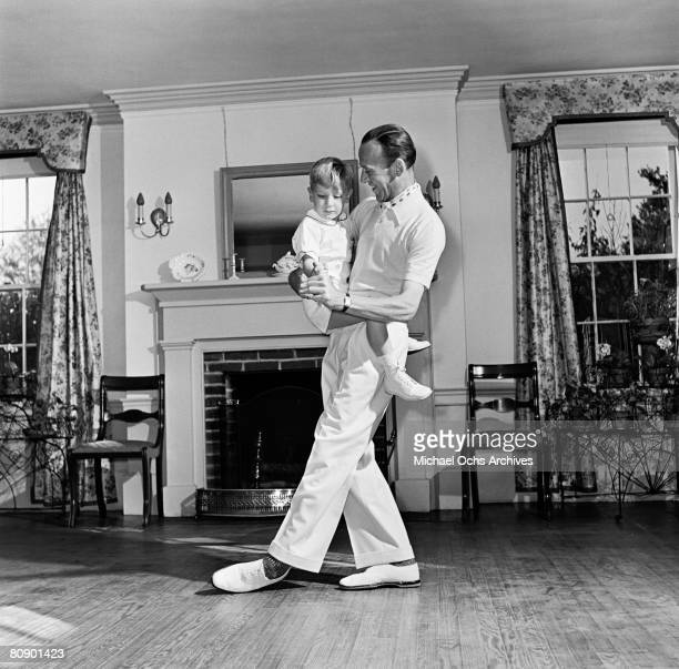 Dancer actor and singer Fred Astaire performs for the camera with his son Fred Jr during a photo session circa 1940 in Los Angeles California