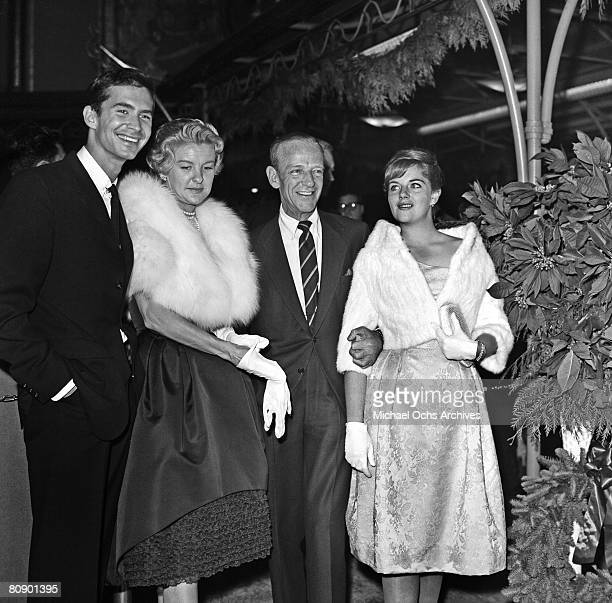 Dancer actor and singer Fred Astaire with his daughter Ava and costar Anthony Perkins with actress Elaine Stritch attend the premiere of 'On The...