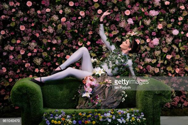 Dancer Alison Parsons poses in a floral display called Greenhouse during staging day for the Harrogate Spring Flower Show on April 25 2018 in...