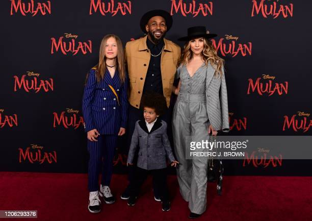 US dancer Allison Holker husband US dancer Stephen Boss and their children attend the world premiere of Disney's Mulan at the Dolby Theatre in...