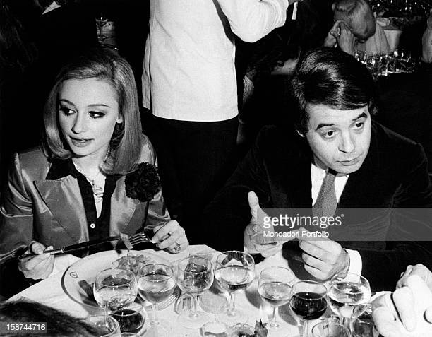 Dancer and presenter Raffaella Carrà and Gianni Boncompagni at dinner at the restaurant La Bussola in the evening when Marlene Dietrich performed...