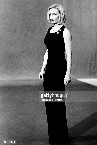 Dancer and presenter Raffaella Carrà in a dark long dress during the rehearsal of the TV show Milleluci by Antonello Falqui. Rome, 1974.
