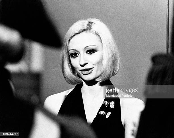 Dancer and presenter Raffaella Carrà in a dress showing her shoulders during the rehearsal of the TV show Milleluci by Antonello Falqui. Rome, 1974.