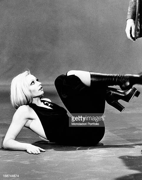 Dancer and presenter Raffaella Carrà on the floor wearing a dress showing her shoulders during the rehearsal of a choreography for the TV show...