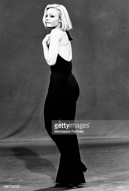 Dancer and presenter Raffaella Carrà wearing an evening dress with trousers showing her back during the rehearsal of the TV show Milleluci by...
