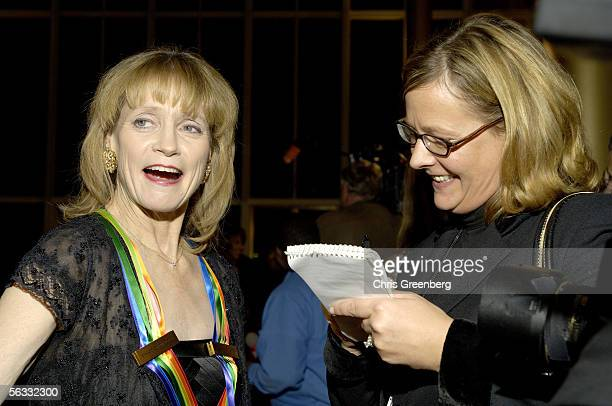 Dancer and teacher Suzanne Farrell speaks to a reporter while on the red carpet at the Kennedy Center December 4 2005 in Washington DC Farrell was...