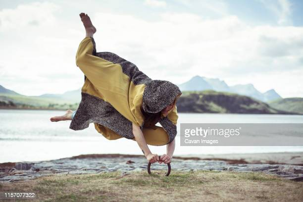 dancer appears to levitate grips to ground - passenger craft stock pictures, royalty-free photos & images